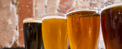 Close up of beers against a brick wall